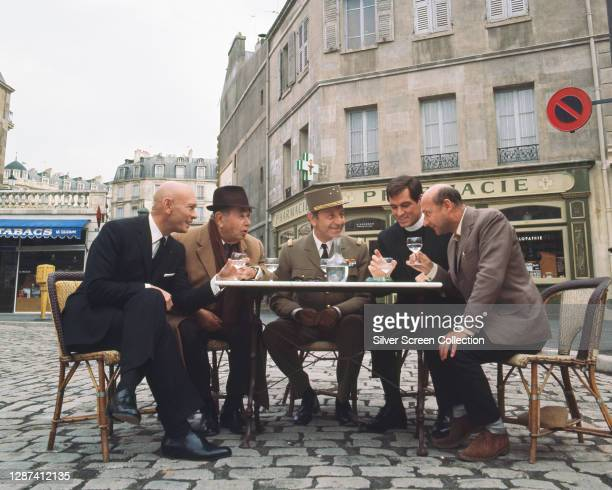 Yul Brynner, Oskar Homolka, Paul Henreid, John Gavin and Donald Pleasence in a promotional portrait for 'The Madwoman of Chaillot', directed by Bryan...