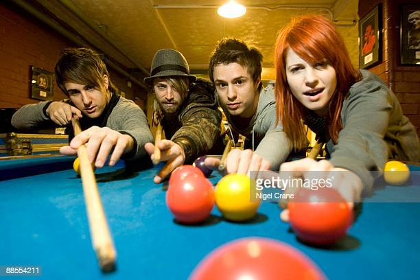 Left to right Zac Farro Jeremy Davis Josh Farro and Hayley Williams of American band Paramore playing pool backstage at the Apollo in Manchester...