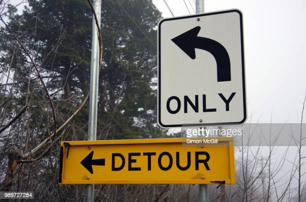 'left turn only' and 'detour' signs - detour sign stock photos and pictures