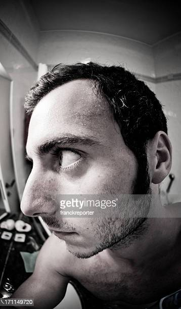 left view of man with Strange face portrait , fisheye lens