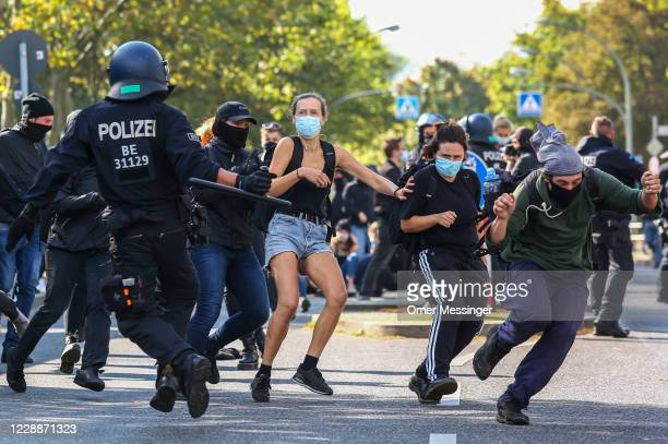 Left wing activists try to sneak through police lines as they demonstrate against supporters of the far-right Third Way neo-Nazi political party...