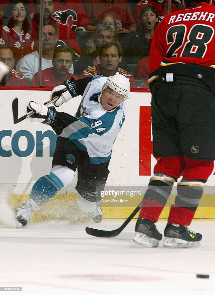 Left wing Alexander Korolyuk #94 of the San Jose Sharks passes the puck against the Calgary Flames during Game six of the 2004 NHL Western Conference Finals at the Pengrowth Saddledome on May 19, 2004 in Calgary, Alberta. The Flames defeated the Sharks 3-1.