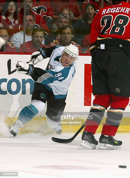 Left wing Alexander Korolyuk of the San Jose Sharks passes the puck against the Calgary Flames during Game six of the 2004 NHL Western Conference...
