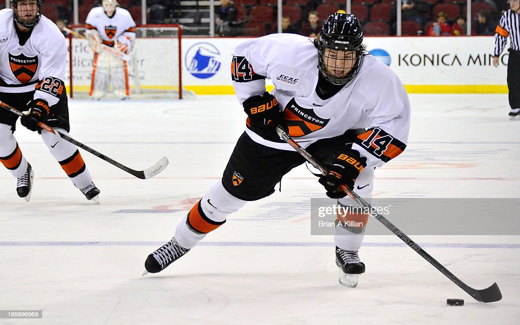 best sneakers c7551 0b440 Left wing Andrew Ammon of the Princeton Tigers skates up ice ...