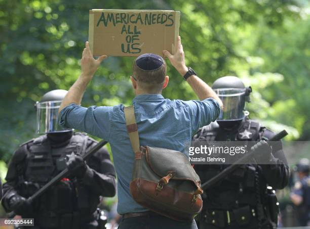 A left wing 'antifa' protester holds up a sign in front of riot police as they cleared a park at a rally on June 4 2017 in Portland Oregon A protest...