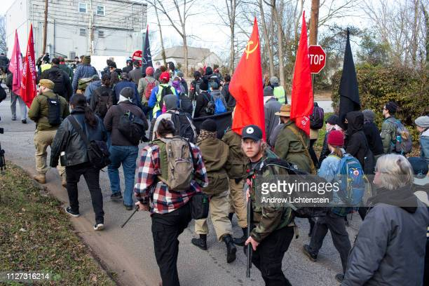 Left wing armed gun clubs act as security for an antifascist march to oppose a Klu Klux Klan rally that was cancelled on February 2 2019 in Stone...
