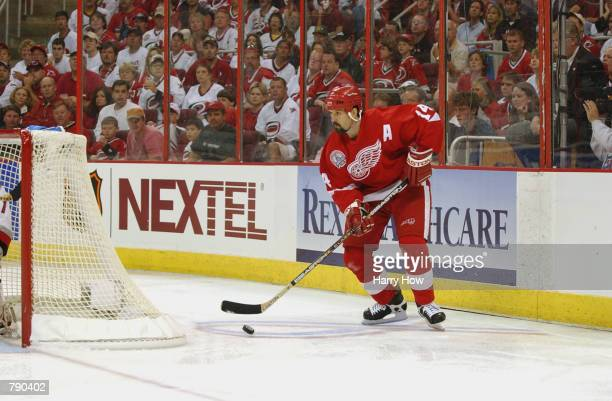 Left Wing Brendan Shanahan of the Detroit Red Wings looks to play the puck from behind the net against the Carolina Hurricanes during game three of...
