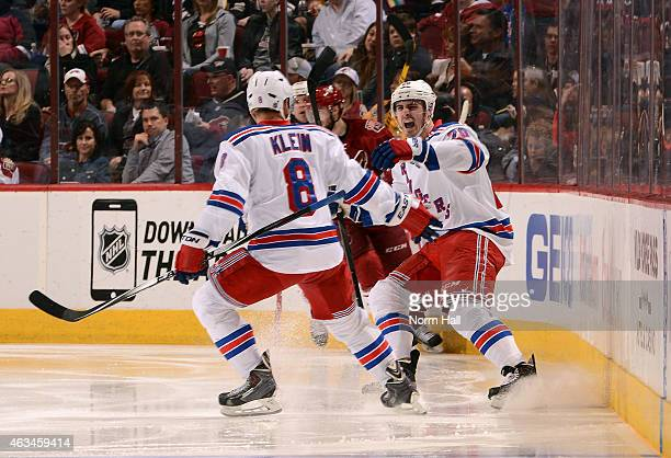 Left wing Chris Kreider of the New York Rangers celebrates his second period goal with defenseman Marc Staal during the NHL game against the Arizona...