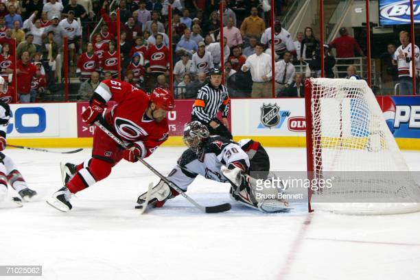 Left wing Cory Stillman of the Carolina Hurricanes attempts to score on goalie Ryan Miller of the Buffalo Sabres in game two of the Eastern...
