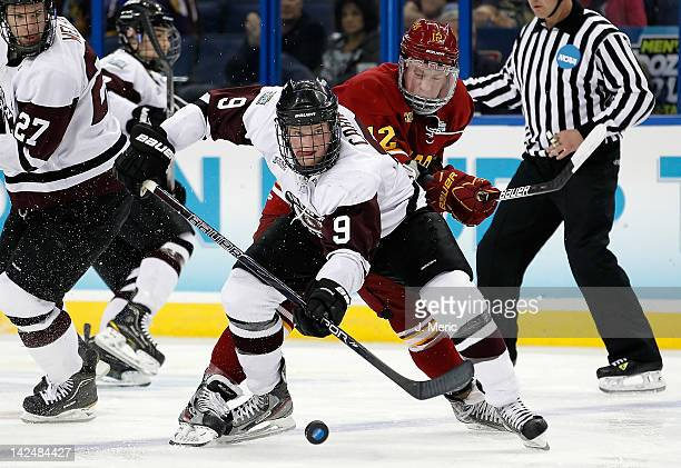 Left wing Daniel Carr of the Union College Dutchman battles right wing TJ Schlueter of the Ferris State Bulldogs for the puck during the NCAA...
