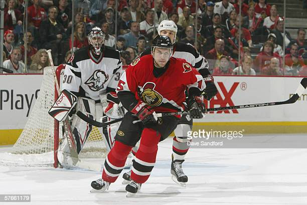 Left wing Dany Heatley of the Ottawa Senators waits for a deflection in front of goaltender Ryan Miller of the Buffalo Sabres in game two of the...