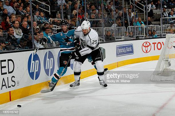 Left wing Dustin Penner of the Los Angeles Kings battles for the puck against defenseman Colin White of the San Jose Sharks at the HP Pavilion on...