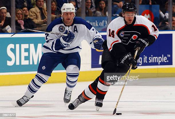 Left wing Gary Roberts of the Toronto Maple Leafs pressures right wing Justin Williams of the Philadelphia Flyers during the game at Air Canada...