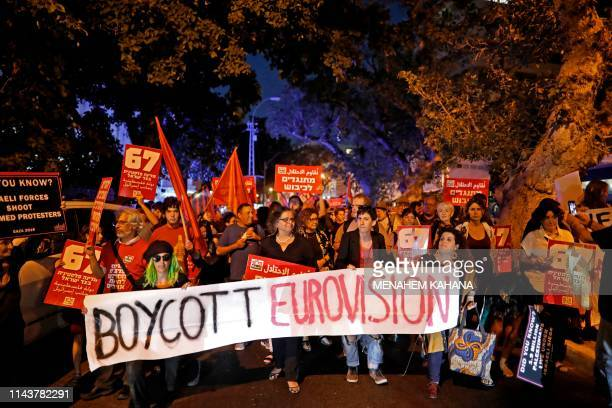 Left wing Israelis hold slogans during a protest against Eurovision on May 14 2019 in Tel Aviv While Israel's 2018 Eurovision victory with Netta...