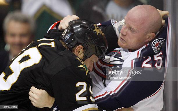 Left wing Jason Chimera of the Columbus Blue Jackets fights with Steve Ott of the Dallas Stars in the first period on November 19 2009 in Dallas Texas