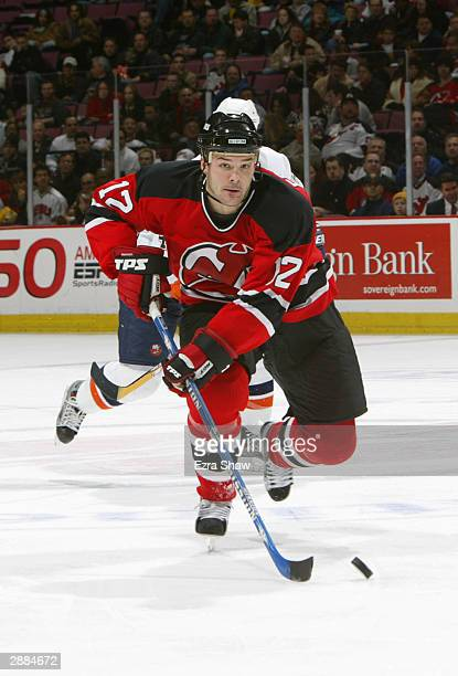 Left wing Jeff Friesen of the New Jersey Devils skates on the ice during the game against the New York Islanders on December 10 2003 at Continental...