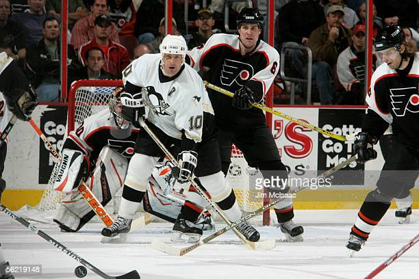 Left wing John LeClair of the Pittsburgh Penguins protects the net from defenseman Chris Therien of the Philadelphia Flyers on November 16, 2005 at...
