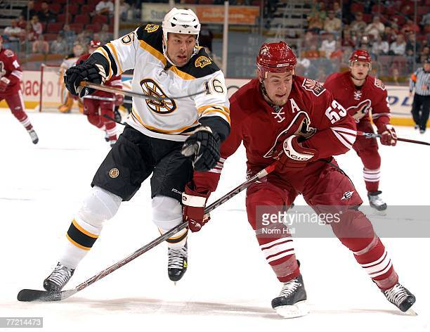 Left wing Marco Sturm of the Boston Bruins and Derek Morris of the Phoenix Coyotes battle for the puck on October 6 2007 at Jobingcom Arena in...