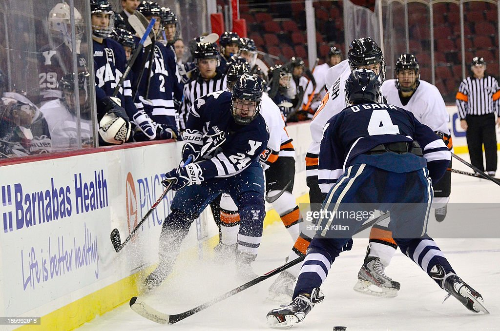 Left wing Mike Doherty #24 of the Yale Bulldogs clears the puck against the Princeton Tigers at Prudential Center on October 26, 2013 in Newark, New Jersey. The Yale Bulldogs defeated the Princeton Tigers, 3-2.