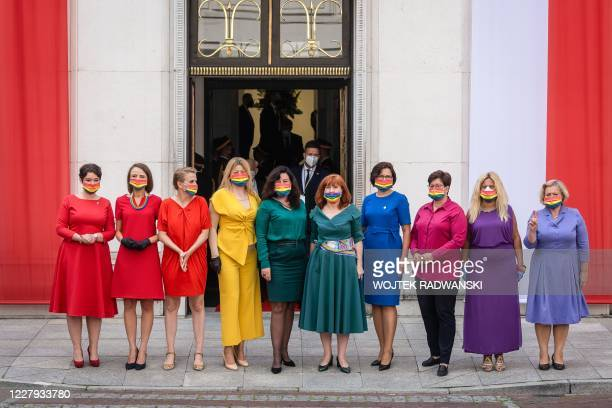 TOPSHOT Left wing parliamentarians dressed in the colors of the rainbow pose in front of the Polish Parliament building after Polish President...