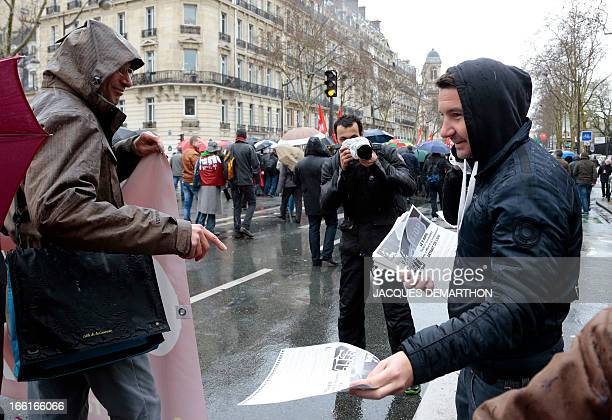 NPA left wing party spokesman Olivier Besancenot distributes leaflets during a demonstration against a bill to reform the country's labour laws based...