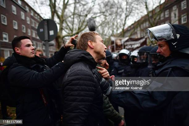 Left wing protesters clash with police during a Neo-Nazis and right-wing supporters protest march to voice their anger at the reporting by...