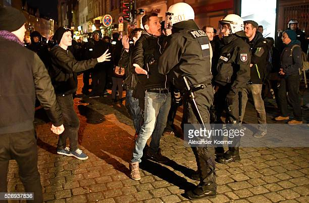 Left wing protesters clash with police forces at 'Rote Flora' after a march on May Day on May 01 2016 in Hamburg Germany Tens of thousands of people...