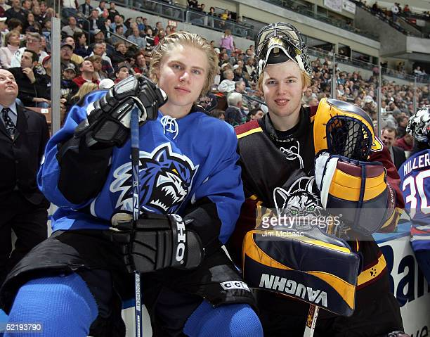 Left wing Sean Bergenheim of the Bridgeport Sound Tigers and goalie Kari Lehtonen of the Chicago Wolves pose for a photo between events at the...