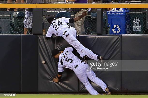 Leftfielder Carlos Gonzalez of the Colorado Rockies and centerfieder Dexter Fowler of the Colorado Rockies collide at the attmept to catch a double...