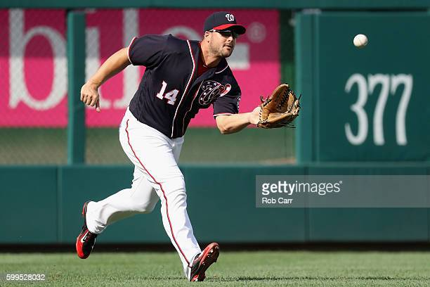 Leftfielder Chris Heisey of the Washington Nationals catches a ball hit by Matt Kemp of the Atlanta Braves for the first out of the second inning at...