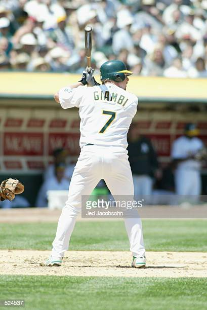 Leftfielder Jeremy Giambi of the Oakland A's awaits the pitch against the Boston Red Sox during the MLB game at Network Associates Coliseum in...
