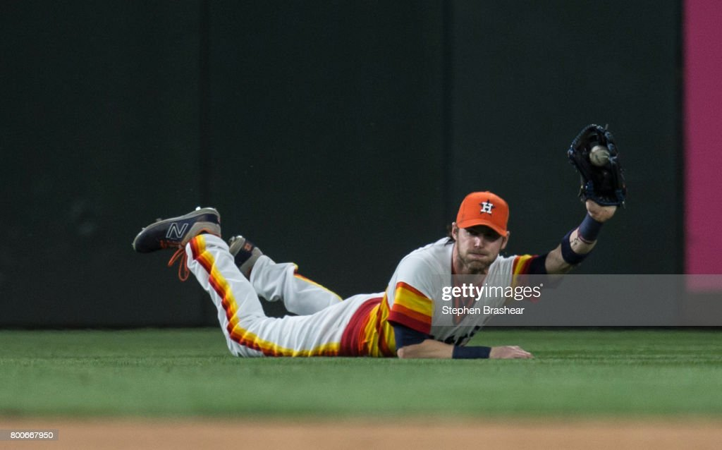 Leftfielder Josh Reddick #22 of the Houston Astros makes a diving catch for an out on a ball hit by Taylor Motter #21 of the Seattle Mariners during the seventh inning of a game at Safeco Field on June 24, 2017 in Seattle, Washington. The Astros won the game 5-2.
