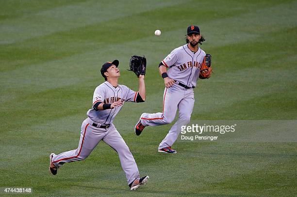 Leftfielder Nori Aoki of the San Francisco Giants catches a fly ball by Troy Tulowitzki of the Colorado Rockies for the second out of the fourth...