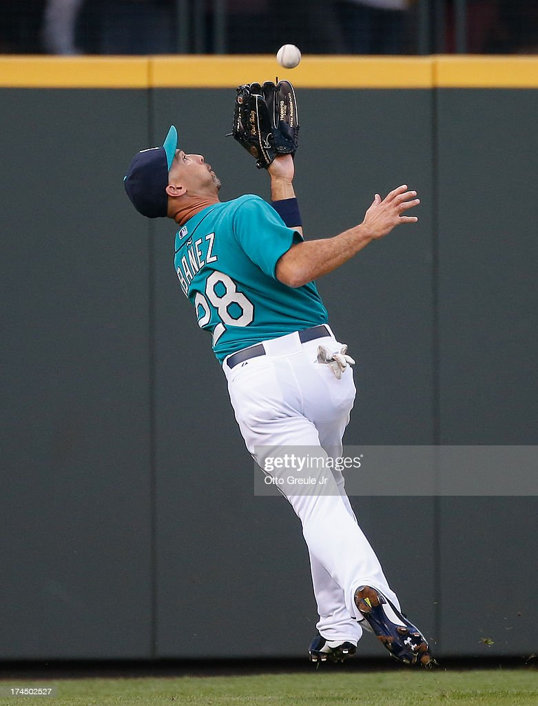 Leftfielder Raul Ibanez #28 of the Seattle Mariners catches a fly ball off the bat of Pedro Florimon (not pictured) of the Minnesota Twins in the third inning at Safeco Field on July 26, 2013 in Seattle, Washington.