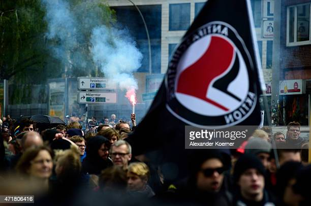 Leftist activists burn flares during the annual May Day demonstrations on May 1 2015 in Hamburg Germany In Germany May Day traditionally brings out a...