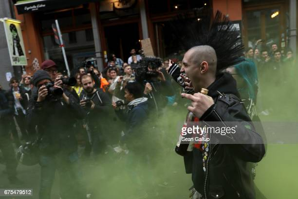 Leftist demonstrators are surrounded by media as they march during the 'Revolutionary 1st of May' May Day protest in Kreuzberg district on May 1 2017...