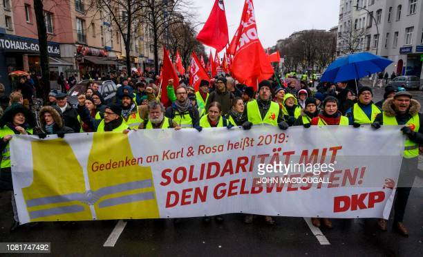 "Leftist demonstrators display a banner reading: ""Remembering Karl and Rosa in 2019 means showing solidarity with the Yellow Vests"" during a march to..."
