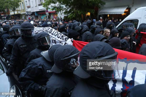 Leftist demonstrators escorted by police in riot gear march during the 'Revolutionary 1st of May' May Day protest in Kreuzberg district on May 1 2017...