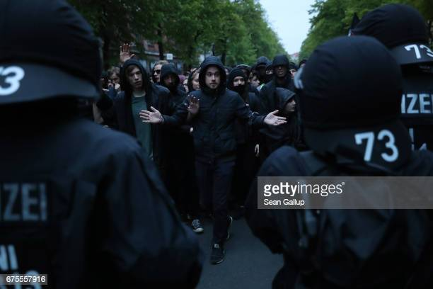 Leftist demonstrators face riot police during the 'Revolutionary 1st of May' May Day protest in Kreuzberg district on May 1 2017 in Berlin Germany...