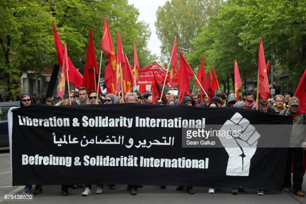 Leftist demonstrators hold up a sign that reads 'Liberation Solidarity International' as they march during the traditional annual May Day protest in...