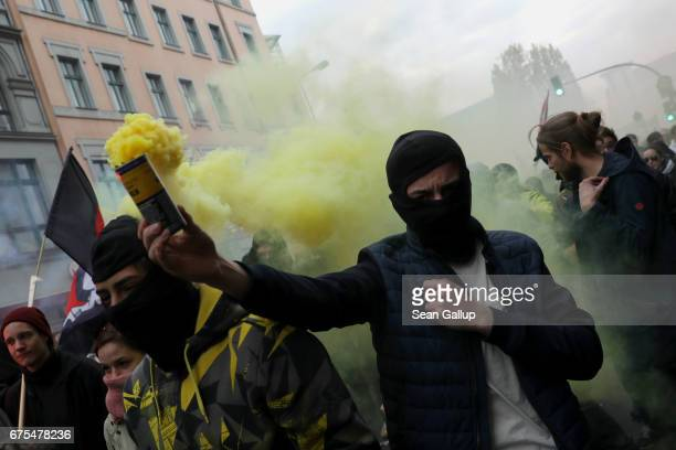 Leftist demonstrators use smoke grenades at they march during the 'Revolutionary 1st of May' May Day protest in Kreuzberg district on May 1 2017 in...