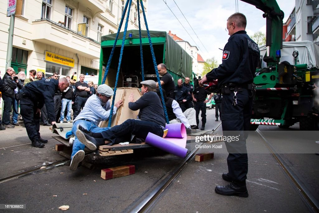Leftist demonstrators who had tied themselves together to prevent a neonazi demonstration are moved by police on May Day on May 1, 2013 in Berlin, Germany. May Day, the international day of labour, is a national holiday in Germany and observed with gatherings by labour unions and political parties. In some cities, including Hamburg and Berlin, the day often ends with violent clahes between police and mostly left-wing demonstrators.
