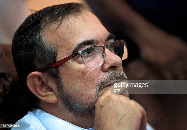 FARC leftist guerrilla commander Timochenko watches on TV the results of a referendum on wether to ratify a peace accord to end a 52year war between...