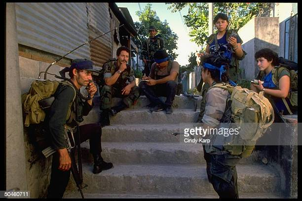 Leftist guerrillas resting taking break from fighting during major offensive in Mexicanos neighborhood of San Salvador El Salvador