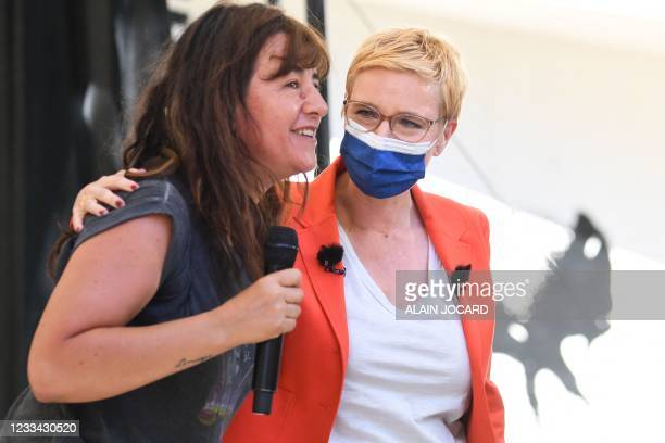 Leftist La France Insoumise party's MP Clementine Autain and candidate for the regional election in Ile-de-France holds French actress Romane...