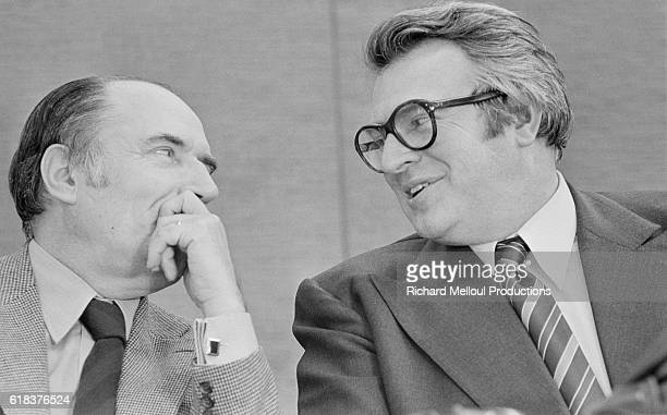 Leftist leaders Francois Mitterrand and Pierre Mauroy talk privately during the French Socialist Party's extraordinary congress in 1976 The Leftists...