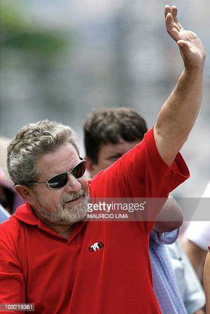 Leftist Luiz Inacio Lula da Silva of the Workers Party waves to supporters in traffic in Sao Paulo 20 October 2002 A Sensus poll out 18 October gave...