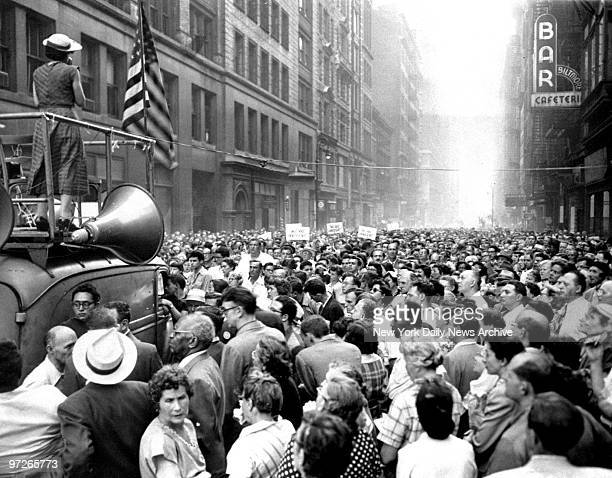 Leftist orator addresses crowd of 5000 Julius and Ethel Rosenberg sympathizers from roof of loudspeaker truck in E 17th St