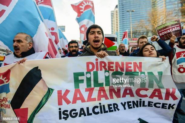 Leftist protesters chant slogans against the US and Israel as they hold a banner reading 'Resisting Palestinian people will win occupiers will lose'...
