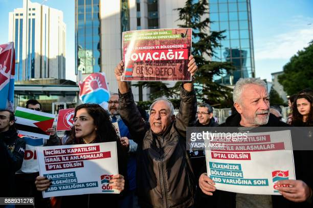 Leftist protesters chant slogans against the US and Israel as they hold placards reading 'US airbase in Incirlik should close Cut all relations with...